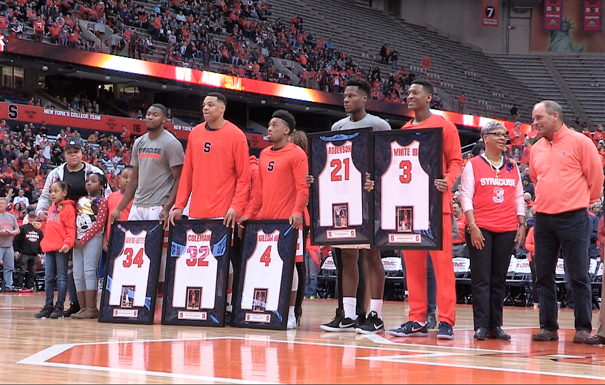 Reflections in an Orange Eye – Senior Day at the Dome
