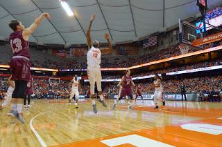 Colgate Hangs Tough, Orange Prevail